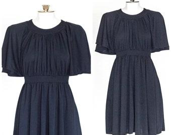 1970s black flutter sleeve dress