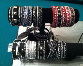 Edgy, Rock-n-roll  bracelets, custom made using zippers, chains& studs for a Bad Ass look you'll love!