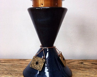 Pillar candle holder/stand. Dark blue glaze finish and embellished with upcycled jewellery.