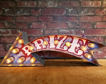 marquee circus letter 'PRIZE' arrow.