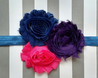 Pink, purple and blue shabby flowers on blue elastic headband for baby, toddler and adult