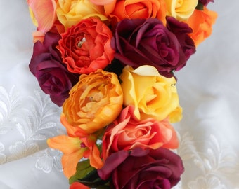 Cascade fall wedding bouquet burgundy , orange, yellows