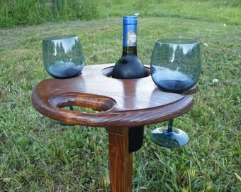 Portable table with holders for wine.