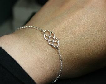 Sterling silver Celtic knot bracelet. Delicate double infinity bracelet.