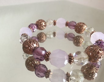 Plum and Lavendar beaded bracelet with copper beads