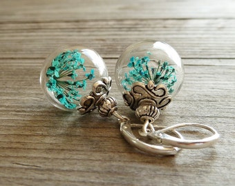 glass bubble earring with genuine flower
