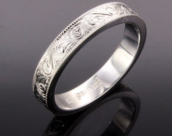 Hand engraved silver wedding band