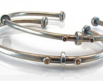 Open silver bangle with semi-precious stones