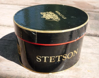 STETSON miniature hat box that obviously won't work with adult hats. A salesman's sample box apparently, but it's cute factor is large .
