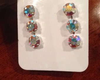 3 stone, 8mm earrings in Aurora borealis crystals in silver finish.