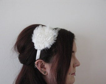 Simple white feather and lace bridal fascinator