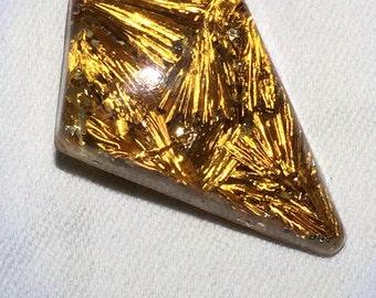 Lucite gold shavings brooch