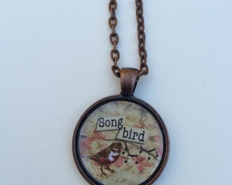 Song bird pendant necklace