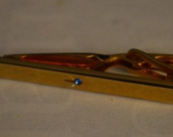 Vintage gold tone tie clip, Blue center rhinestone