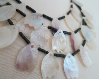 Three Strand Carved Shell Necklace