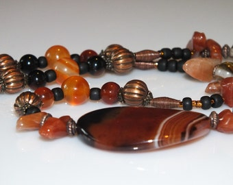 Dream Agate Oval focal bead with carnelian, red agate , watermelon tourmaline and copper necklace and earring set.