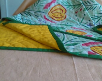 Hand quilted lap quilt.