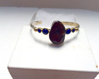 Sterling silver bracelet with brass accents, boulder opal and lapis.