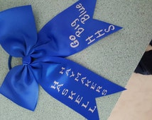 Custom made hair bow. You choose team name an bow colors.