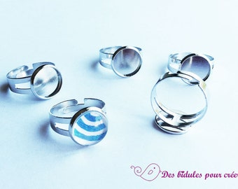 5 racks of silver rings and cabochons 12mm glass