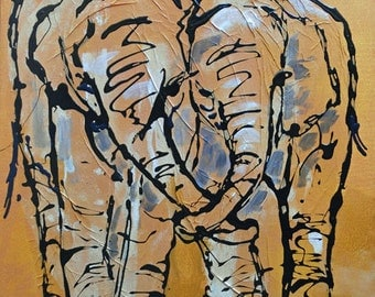 Painting young twin elephants