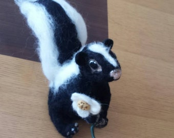 Needlefelted skunk with flower