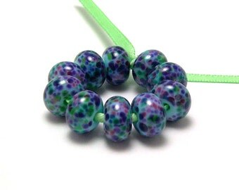 Handmade Lampwork Glass Mini Beads in Purple, Pink, and Green Multicolor - a set of 10 beads - Violet Garden on Light Blue