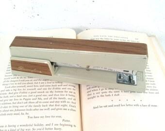 Vintage Swingline stapler in cream and woodgrain, 1970s office