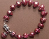 Hand knotted semi precious garnets, fresh water pearls and Bali sterling silver beaded magnetic bracelet