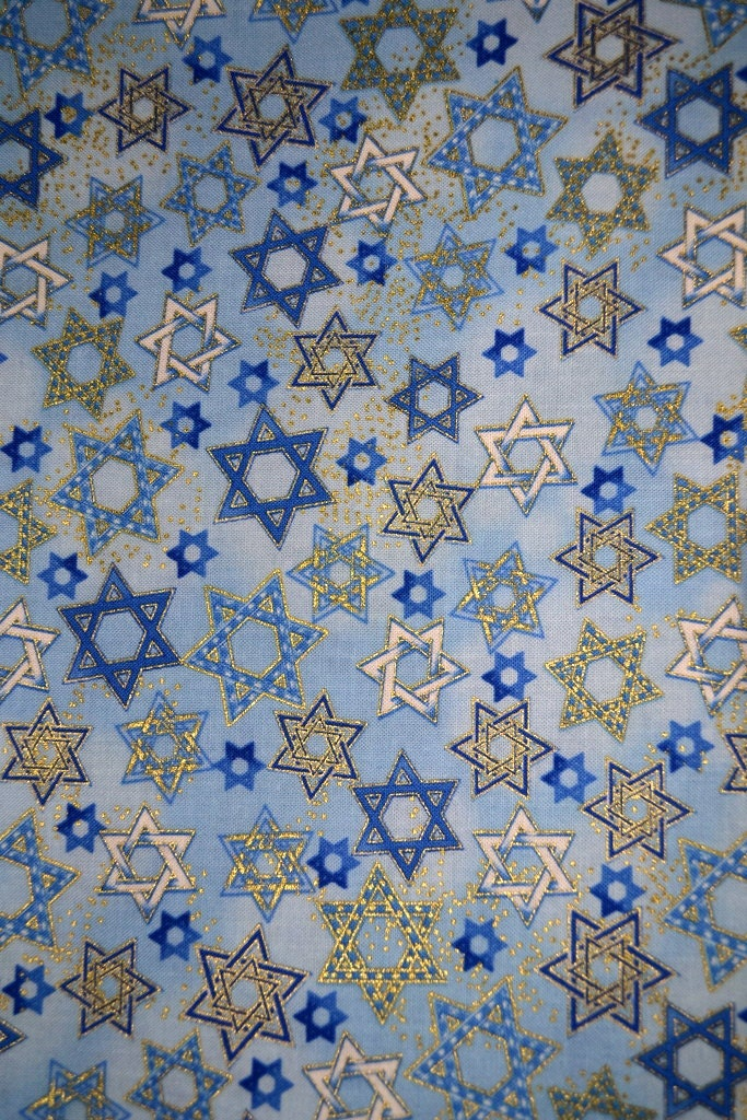 Judaic fabric white blue and gold stars on light blue half for Star fabric australia