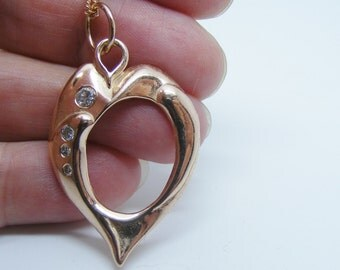Solid Rose Gold Liquid Heart pendant with diamonds on a rose gold chain, solid rose gold jewelry
