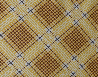 1 yard of 36-inch wide vintage cotton fabric, pretty yellow geometric pattern, original tag and finish
