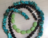 Set of gemstone bead strands in blue, green and black