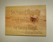 Don't sweat the petty things and don't pet the sweaty things. George Carlin - Carved Wooden Plaque -  08054