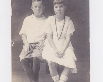 1920-30s  picture post card of a young boy and girl