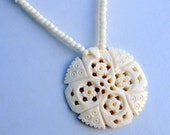 Faux Ivory Necklace withRound Medallion Shaped Focal Carved with Cross