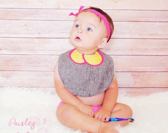 Yellow pan collar baby bib with mini pom poms