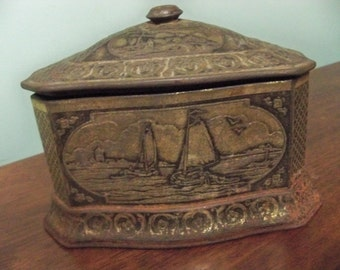 antique ships and windmill tin