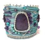 Shibori silk bead embroidered cuff bracelet with Sugilite cabochon