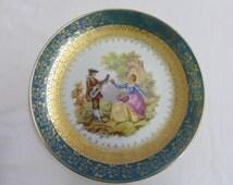 Gold gilt and emerald trimmed romantic Limoges Fragonard plate