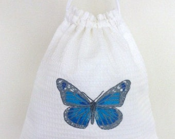 SALE: White cotton drawstring bag with blue butterfly