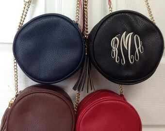 Monogrammed circle cross body purse black red brown navy