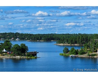 Fine Art Color Photography of Blue Sky and Clouds Over the Islands in the Archipelago of Sweden