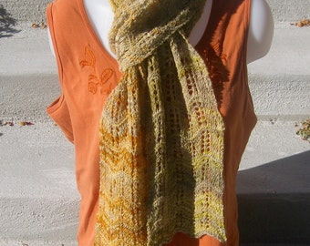 Falling leaves: lace-knit wool scarf in olive, cream, and orange