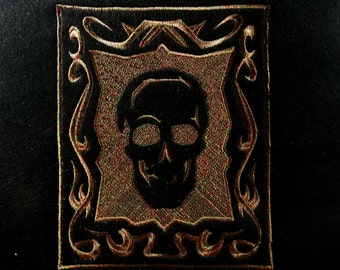 """6.75″ x 8.25″ Embroidered """"Embossed Skull"""" Tapestry (15.5″ x 17″ overall, black fleece)"""