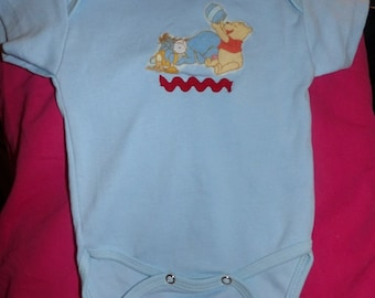 12 months to 18 months light blue knit romper with Winnie The Pooh appliques - k02a
