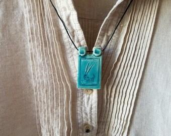 Vintage handmade ceramic clay capricorn pendant in turquoise glaze