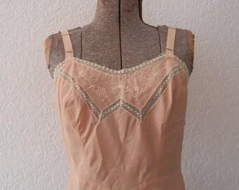 Vintage peachy pink 1950s dress slip