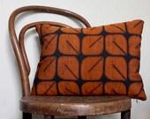 Geometric Woven Ikat Decorative Pillow. Orange and Black Retro Cushion Cover