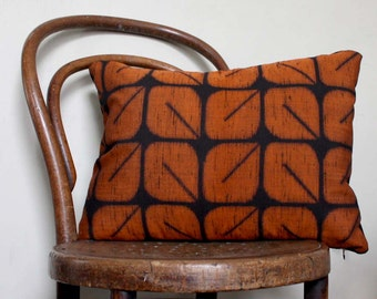 Geometric Woven Ikat Decorative Pillow. Orange and Black Retro Cushion Cover